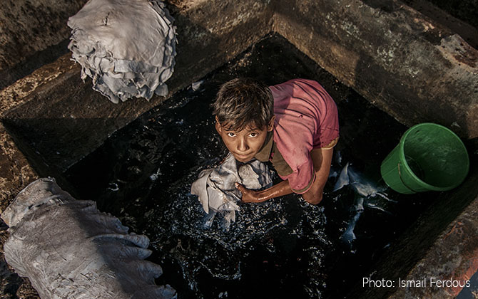 A child worker working in a hazardous lather industry in Hazaribag, Dhaka, Bangladesh.